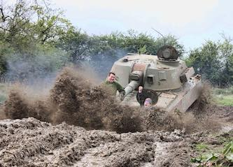 group of bucks riding in army tank