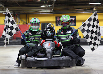 buck in go kart with start line flags either side