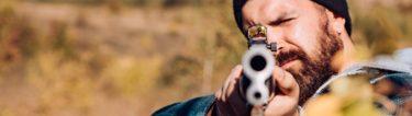 buck pointing a shotgun