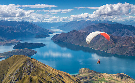 buck skydiving over auckland river and mountains