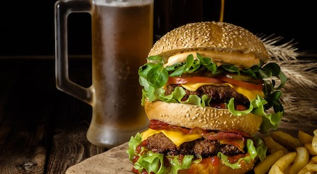 big juicy burger and beer