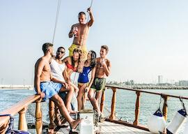 group of bucks and waitresses on boat cruise