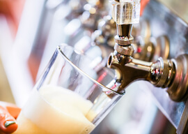 craft beer being poured from beer tap