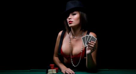 waitress in lingerie holding poker cards