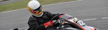 buck racing a go kart