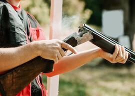 buck reloading shotgun after shooting
