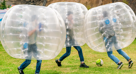 three bucks playing bubble soccer