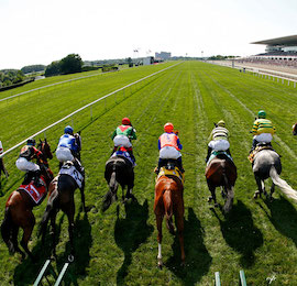 race horses racing on race track