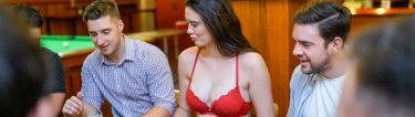 group of bucks playing poker with beautiful waitress