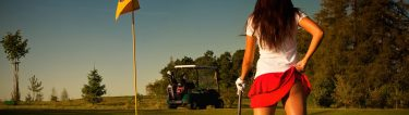 cheeky golf bunny holding up red skirt showing bum