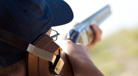 buck clay shooting with shotgun
