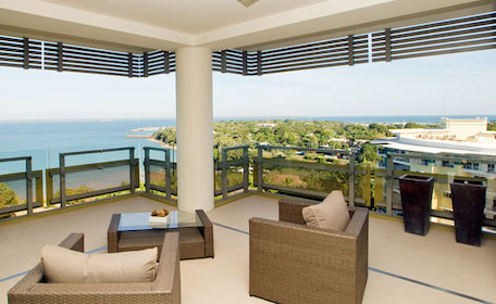 balcony with chairs overlooking waterfront view of Darwin