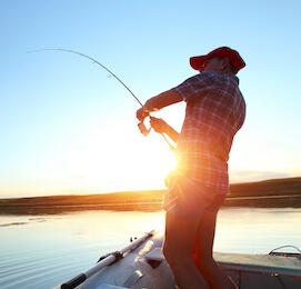 buck on a lake fishing