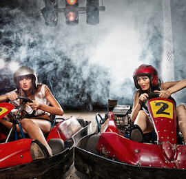 two stunning women on go karts