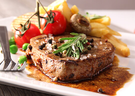 gourmet steak and chips with cherry tomoatos