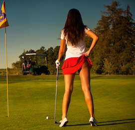 golf bunny on golf green with red skirt being cheeky