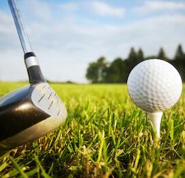 golf club and golf ball on a tee
