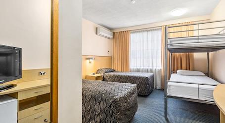 interior apartment view bunk beds and two singles bucks accommodation hobart