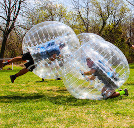 the stags bumping each other playing bubble soccer