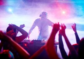 dj infront of nightclub crowd