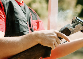 bucks holding a shotgun