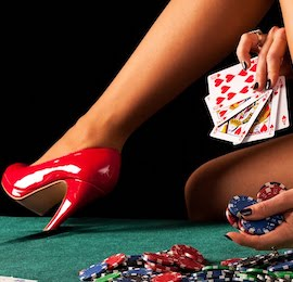 stunning girl holding poker chips and cards