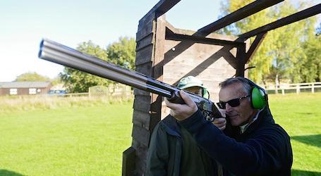group of bucks shooting clay gun