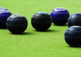 4 lawn bowls on the green