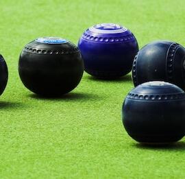 group of bucks playing lawn bowls