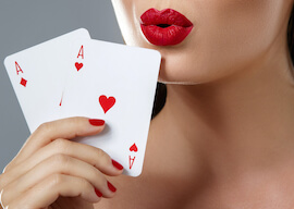 waitress with red lipstick holding pair of aces
