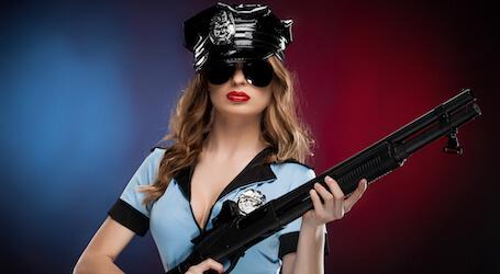 sexy waitress holding a fake gun in uniform