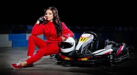 sexy go kart racing girl in red race suit