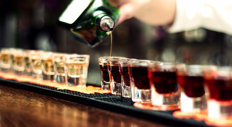 jager being poured into shot glasses