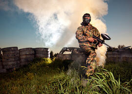 buck on paintball field with smoke in the background