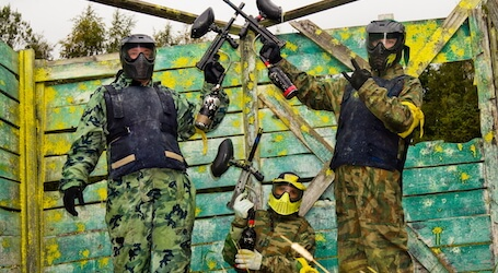three bucks posing after victory on the paintball field