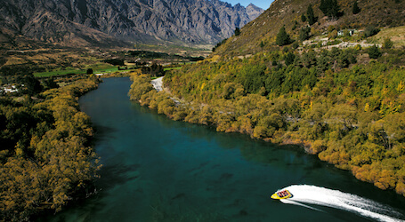 jet boat racing through queenstown river