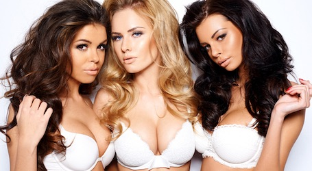 three sexy topless waitresses in white lingerie