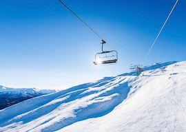 ski lift and snowy mountains in queenstown