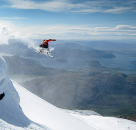 buck snowboarding off mountain