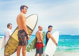 group of bucks surfing in byron bay