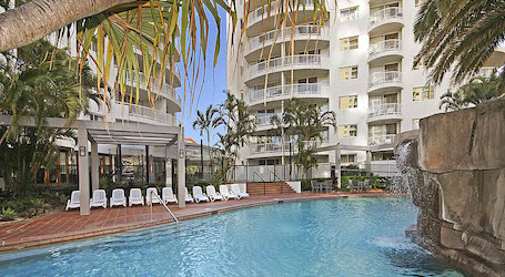 pool and sun chairs in surfers paradise apartment