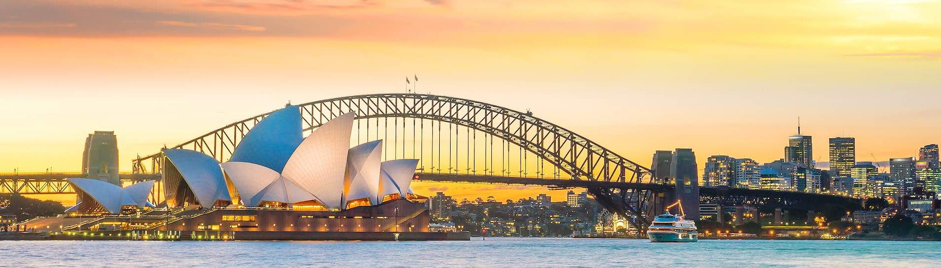bucks party destination sydney sun setting over sydney harbour bridge and sydney opera house