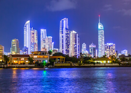 water view of Gold Coast at night with sky scrapers lit up