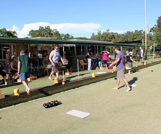 group of bucks playing lawn bowls