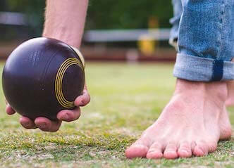 buck playing lawn bowls