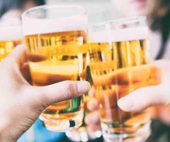 group of bucks cheering beers