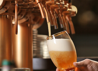bartender pouring beer at byron bay brewery