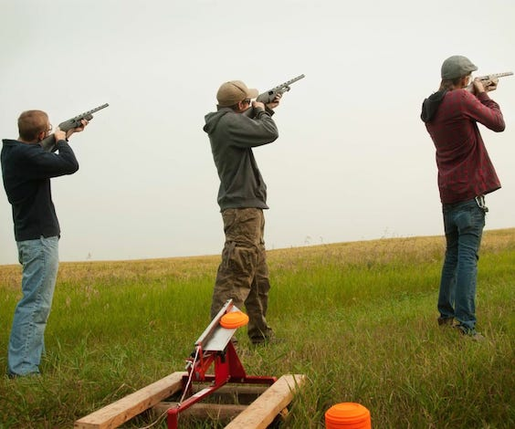group of bucks shooting clay guns