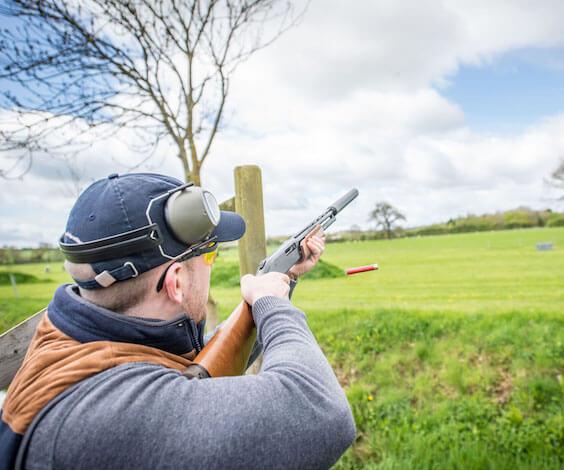 buck shooting clay gun