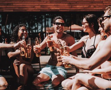 group of bucks drinking by pool